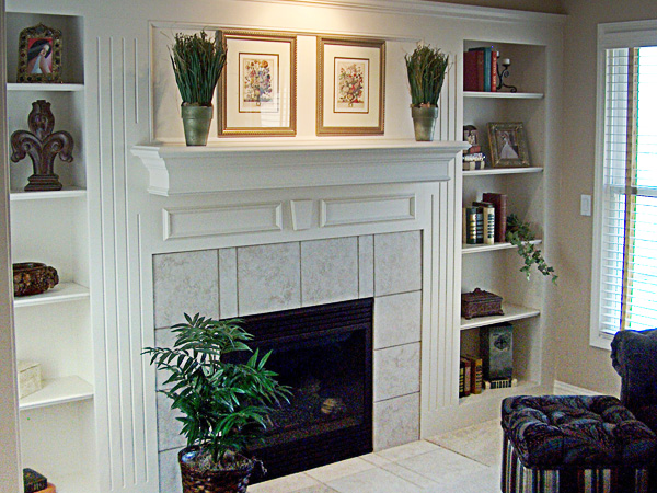 This is a formal custom wall unit with a double mantel and bookcases